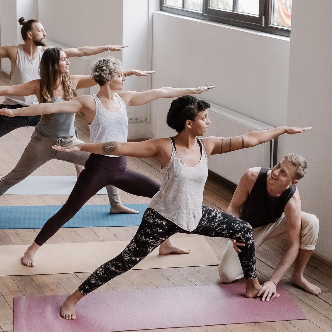 Urban Warrior Yoga Assisted Warrior 2